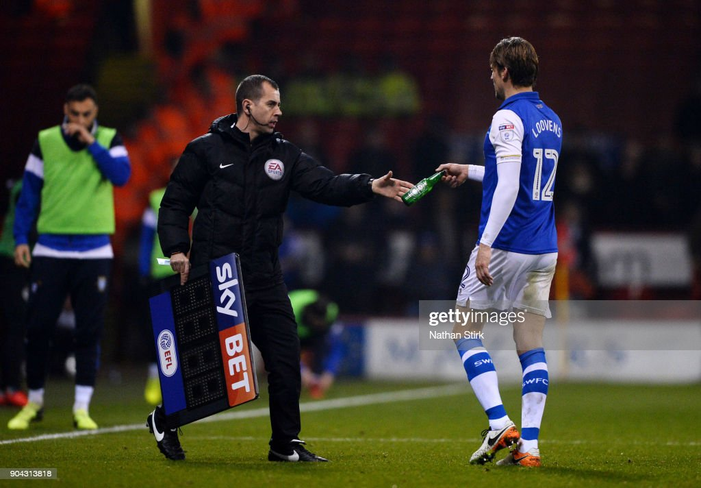 Glenn Loovens of Sheffield Wednesday has a bottle thrown at him after being sent off during the Sky Bet Championship match between Sheffield United and Sheffield Wednesday at Bramall Lane on January 12, 2018 in Sheffield, England.