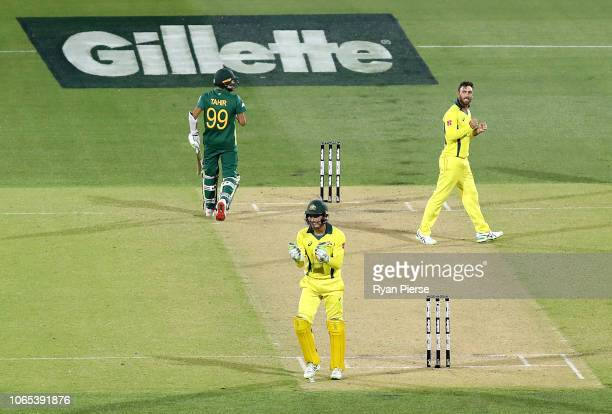 Glenn Maxwell and Alex Carey celebrate victory during game two of the Gillette One Day International series between Australia and South Africa at...