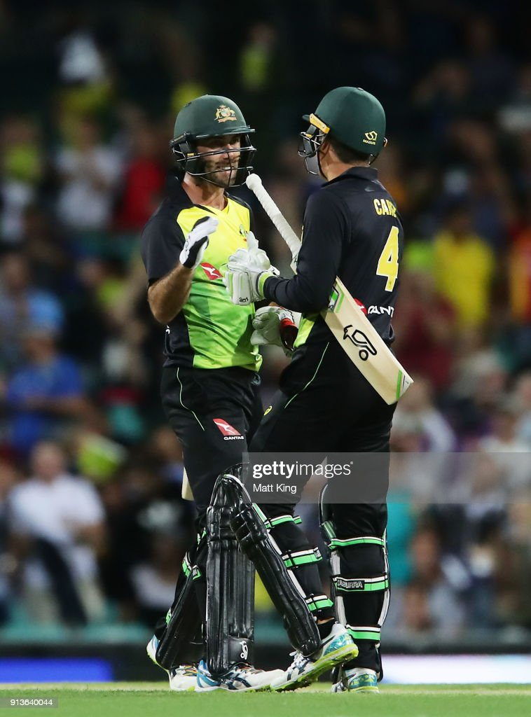 Glenn Maxwell and Alex Carey of Australia celebrate victory during game one of the International Twenty20 series between Australia and New Zealand at Sydney Cricket Ground on February 3, 2018 in Sydney, Australia.