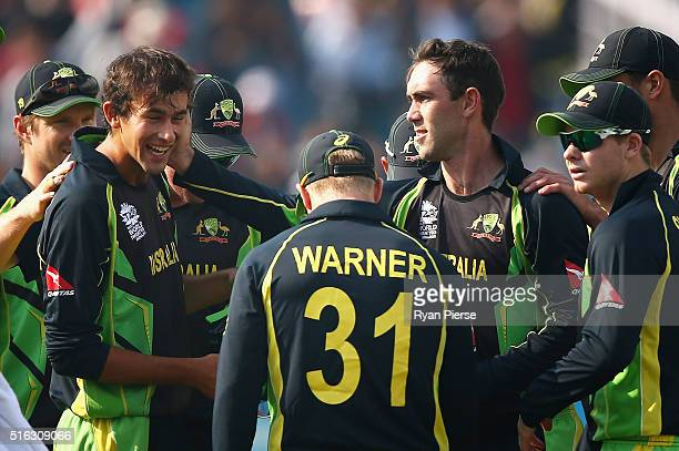 Glenn Maxwell and Ashton Agar of Australia celebrate after combining to take the wicket of Kane Williamson of New Zealand during the ICC World...