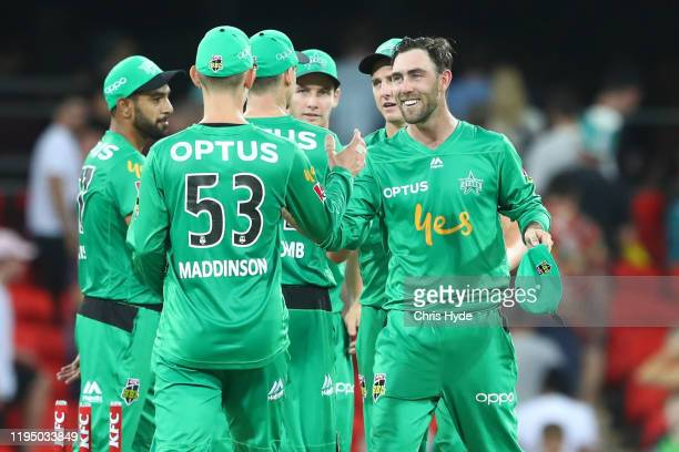 Glenn Maxwell and the Stars celebrate winning the Big Bash League Match between the Brisbane Heat and the Melbourne Stars at Metricon Stadium on...