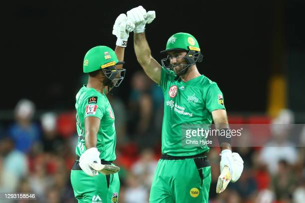 Glenn Maxwell celebrates 50 runs with team mate Nicholas Pooran of the Stars bat during the Big Bash League match between Sydney Sixers and the...