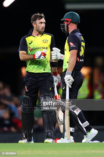 Glenn Maxwell of Australia and Chris Lynn of Australia fist bump midmitch during game one of the International Twenty20 series between Australia and...