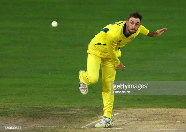 Glenn Maxwell of Australia bowls during the 5th One Day International match between Pakistan and Australia at Dubai International Stadium on March 31...