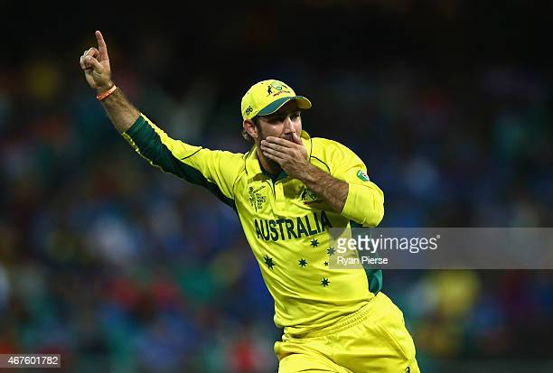 Glenn Maxwell of Australia celebrates after running out MS Dhoni of India during the 2015 Cricket World Cup Semi Final match between Australia and...