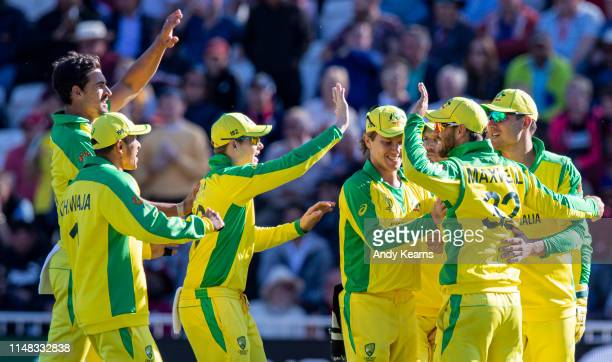 Glenn Maxwell of Australia celebrates after taking a catch to dismiss Andre Russell of West Indies during the Group Stage match of the ICC Cricket...