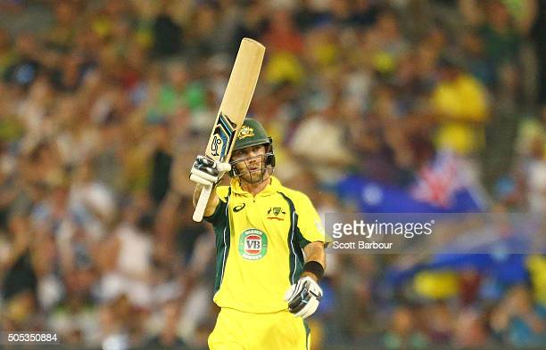 Glenn Maxwell of Australia celebrates as he reaches his fifty during game three of the One Day International Series between Australia and India at...