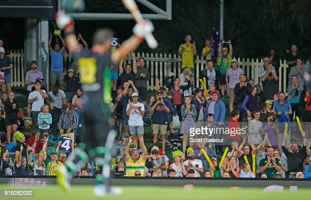 Glenn Maxwell of Australia celebrates his century after hitting a six from the last ball as the crowd cheer during the Twenty20 International match...