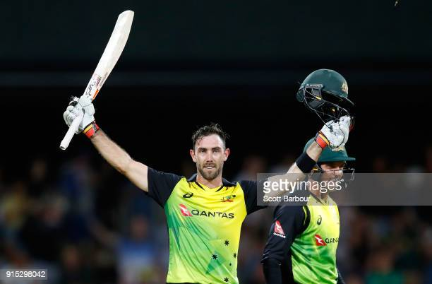 Glenn Maxwell of Australia celebrates his century after hitting a six from the last ball during the Twenty20 International match between Australia...