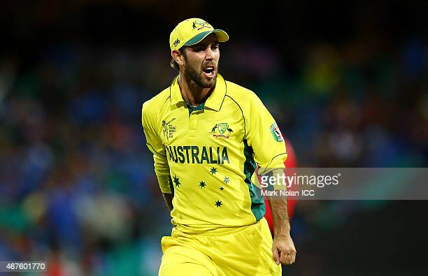 Glenn Maxwell of Australia celebrates running out MS Dhoni of India during the 2015 Cricket World Cup Semi Final match between Australia and India at...