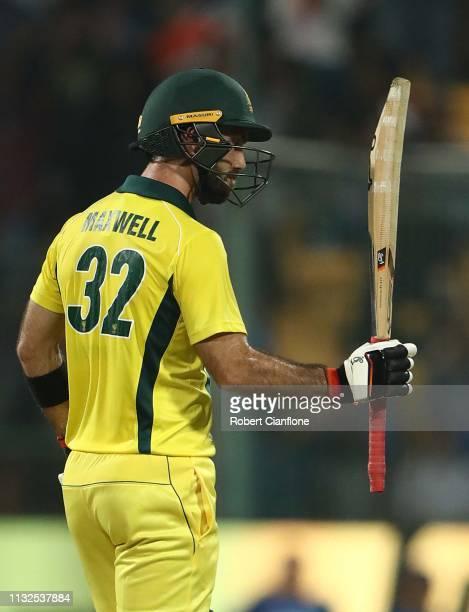 Glenn Maxwell of Australia celebrates scoring his century during game two of the T20I Series between India and Australia at M Chinnaswamy Stadium on...