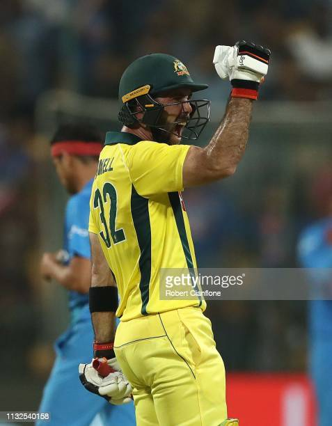 Glenn Maxwell of Australia celebrates scoring the winning runs during game two of the T20I Series between India and Australia at M. Chinnaswamy...