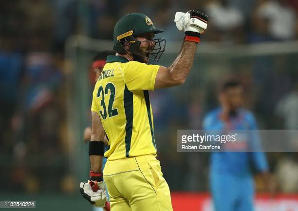Glenn Maxwell of Australia celebrates scoring the winning runs during game two of the T20I Series between India and Australia at M Chinnaswamy...