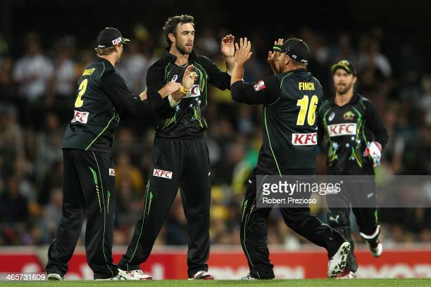 Glenn Maxwell of Australia celebrates taking the wicket of Eoin Morgan of England during game one of the International Twenty20 series between...