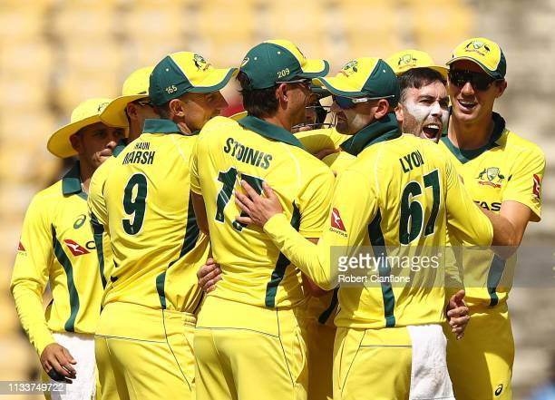 Glenn Maxwell of Australia celebrates taking the wicket of of Shikhar Dhawan of India during game two of the One Day International series between...