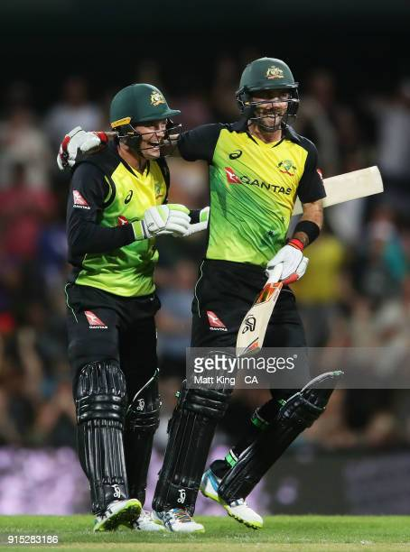 Glenn Maxwell of Australia celebrates victory with Alex Carey after scoring a century during the Twenty20 International match between Australia and...