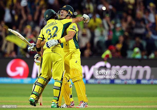 Glenn Maxwell of Australia celebrates with Shane Watson of Australia after Australia takes victory during the 2015 ICC Cricket World Cup match...