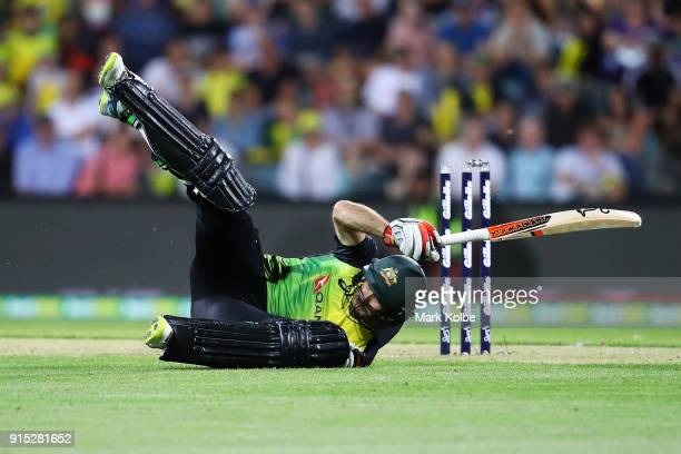 Glenn Maxwell of Australia falls after diving to make his ground during the Twenty20 International match between Australia and England at Blundstone...