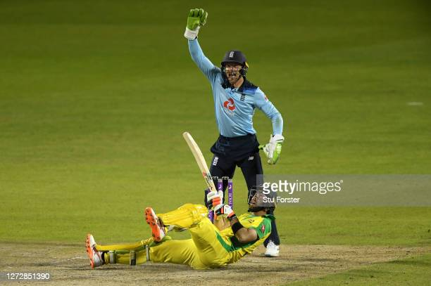 Glenn Maxwell of Australia falls over whilst attempting a reverse sweep as Jos Buttler of England appeals for LBW during the 3rd Royal London One Day...