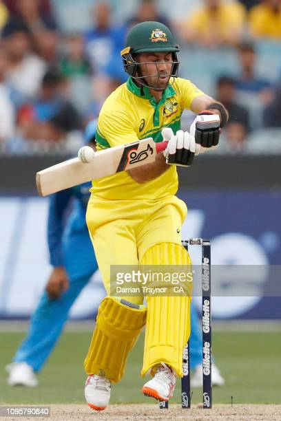 Glenn Maxwell of Australia gets a top edge during game three of the One Day International series between Australia and India at Melbourne Cricket...