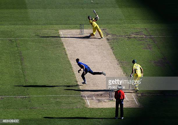 Glenn Maxwell of Australia hits down the ground off the bowling of Steven Finn of England during the 2015 ICC Cricket World Cup match between England...