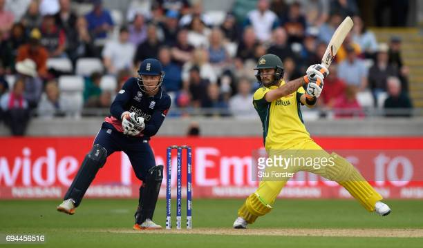 Glenn Maxwell of Australia hits out watched by Jos Buttler during the ICC Champions Trophy match between England and Australia at Edgbaston on June...