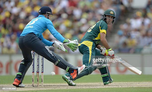 Glenn Maxwell of Australia hits past Jos Buttler of England during the final match of the Carlton Mid One Day International series between Australia...