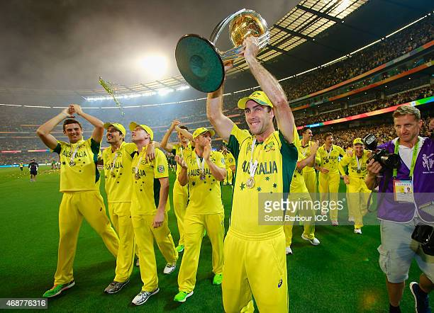 Glenn Maxwell of Australia holds the World Cup trophy aloft after Australia won the 2015 ICC Cricket World Cup final match between Australia and New...