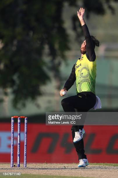 Glenn Maxwell of Australia in bowling action during the India and Australia warm Up Match prior to the ICC Men's T20 World Cup at on October 20, 2021...