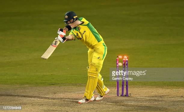 Glenn Maxwell of Australia is bowled by Chris Woakes of England during the 2nd Royal London One Day International Series match between England and...