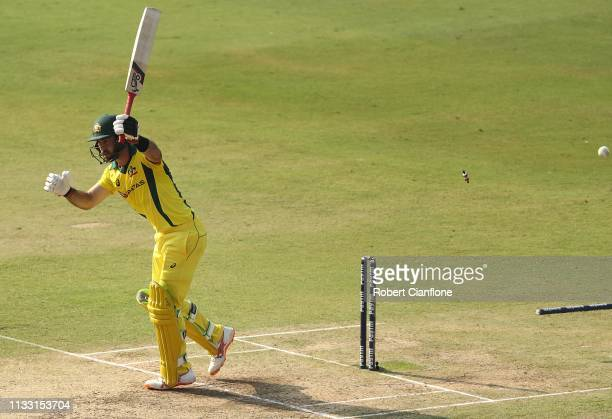 Glenn Maxwell of Australia is bowled by Mohammed Shami of India during game one of the One Day International series between India and Australia at...