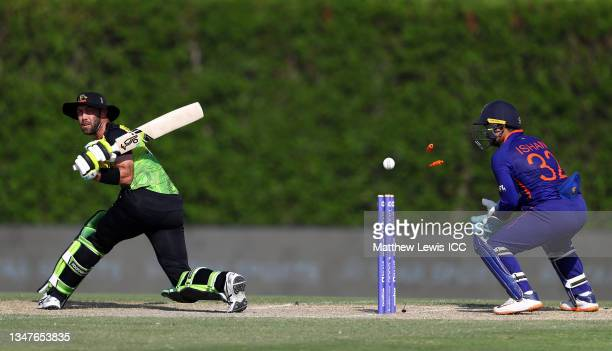 Glenn Maxwell of Australia is bowled by Rahul Chahar of India as team mate Ishan Kishan looks on during the India and Australia warm Up Match prior...