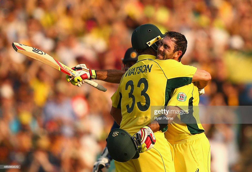 Glenn Maxwell of Australia is congratulated by Shane Watson of Australia after reaaching his century during the 2015 ICC Cricket World Cup match between Australia and Sri Lanka at Sydney Cricket Ground on March 8, 2015 in Sydney, Australia.