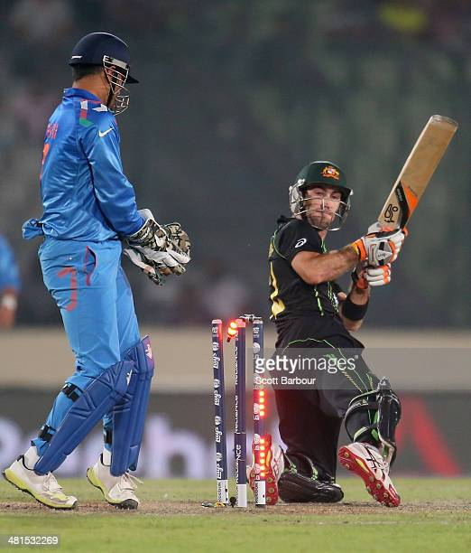 Glenn Maxwell of Australia is out bowled as MS Dhoni of India looks on during the ICC World Twenty20 Bangladesh 2014 match between India v Australia...