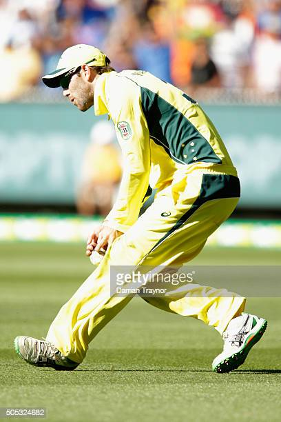 Glenn Maxwell of Australia just holds onto to catch to dismiss MS Dhoni of India of the bowling o John Hastings of Australia during game three of the...