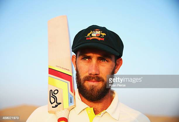 Glenn Maxwell of Australia poses as the sun rises over Al Khatim Sand Dunes on October 29 2014 in Abu Dhabi United Arab Emirates
