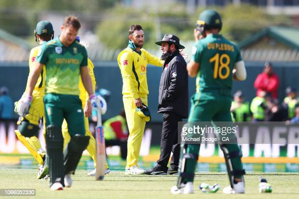 Glenn Maxwell of Australia reacts to the umpire after his dismissal of David Miller of South Africa was later overturned during game three of the One...