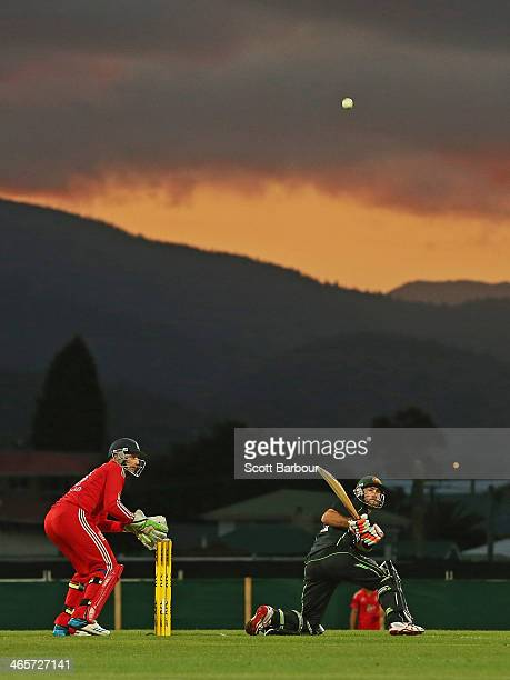 Glenn Maxwell of Australia reverse sweeps during game one of the International Twenty20 series between Australia and England at Blundstone Arena on...