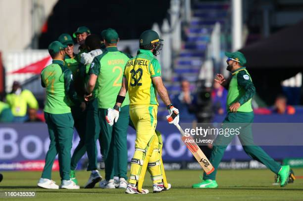 Glenn Maxwell of Australia walks off after being caught and dismissed by Quinton De Kock of South Africa during the Group Stage match of the ICC...