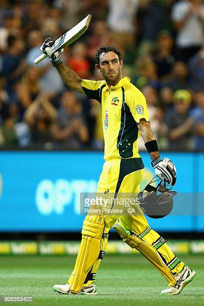 Glenn Maxwell of Australia walks off after being dismissed by Umesh Yadav of India during game three of the One Day International Series between...