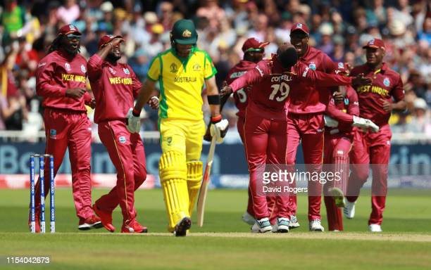 Glenn Maxwell of Australia walks off the pitch after being dismissed by Sheldon Cottrell during the Group Stage match of the ICC Cricket World Cup...