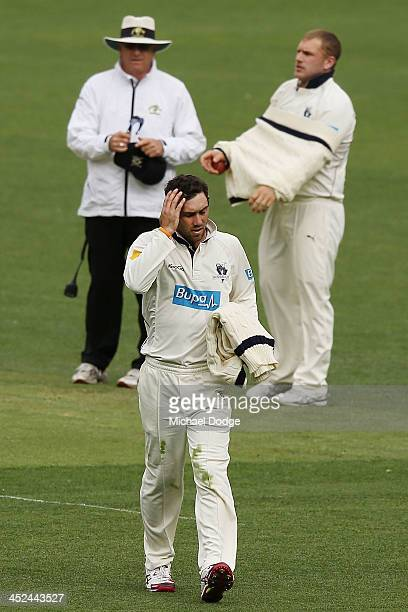 Glenn Maxwell of the Bushrangers walks off with an injured right leg sustained from bowling during day one of the Sheffield Shield match between the...
