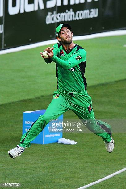 Glenn Maxwell of the Stars catches the ball over the line but then throws it back over saving runs during the Big Bash League match between the...