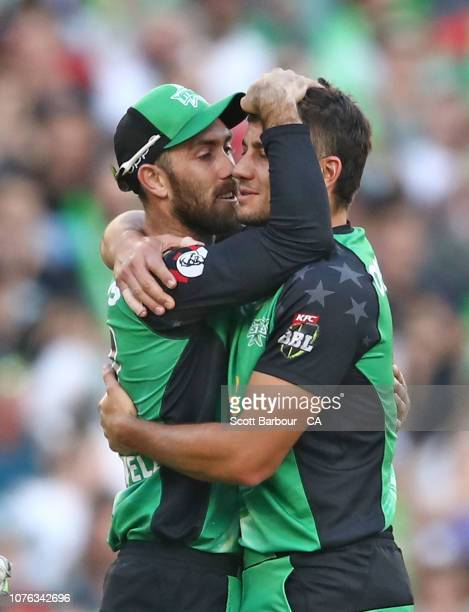 Glenn Maxwell of the Stars embraces Marcus Stoinis after taking a catch from his bowling to dismiss Mohammad Nabi of the Renegades during the Big...