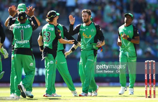 Glenn Maxwell of the Stars is congratulated by his teammates after taking a wicket during the Big Bash League match between the Melbourne Stars and...