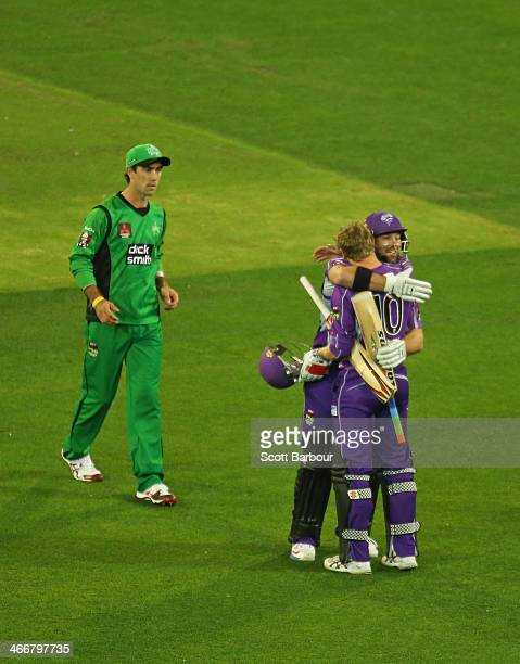 Glenn Maxwell of the Stars looks on as George Bailey and Travis Birt of the Hurricanes celebrate winning the Big Bash League Semi Final match between...