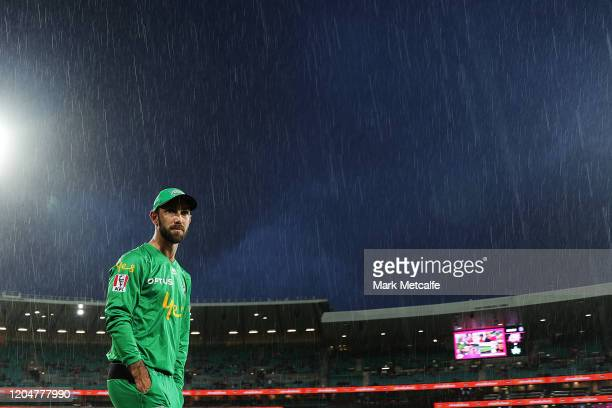 Glenn Maxwell of the Stars looks on as heavy rain falls during a rain delay before the Big Bash League Final match between the Sydney Sixers and the...
