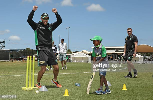 Glenn Maxwell of the Stars plays Milo kids cricket with children during the Melbourne Stars Family Day at Casey Fields on December 18 2016 in...