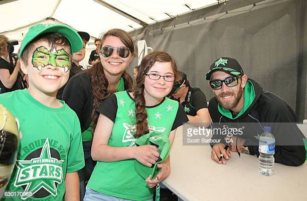 Glenn Maxwell of the Stars poses for a photo with supporters during the Melbourne Stars Family Day at Casey Fields on December 18 2016 in Melbourne...