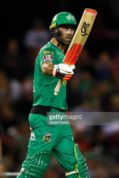 Glenn Maxwell of the Stars raises his bat after making fifty runs during the Big Bash League match between the Melbourne Renegades and the Melbourne...